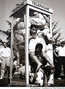 guys stuffed in a phone booth