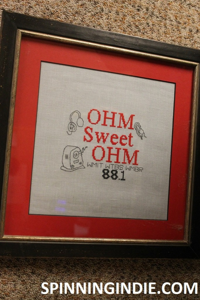 Ohm Sweet Ohm cross stitch at college radio station WMBR