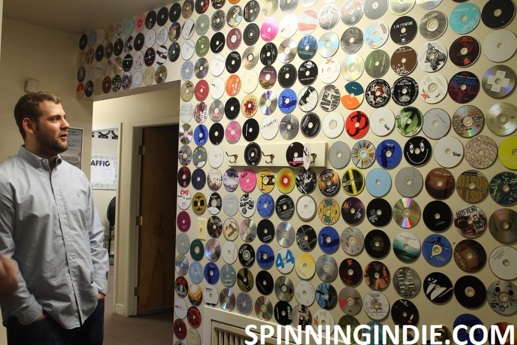 Station Manager and wall of CDs at WONC