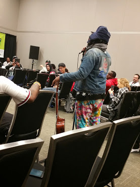 "A hip hop performer offer some impromptu lines at the SXSW Hip Hop ""deep dive"""