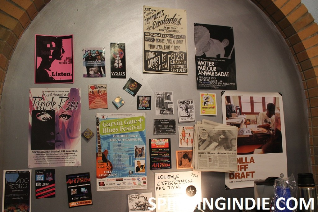 posters and flyers on wall at ARTxFM
