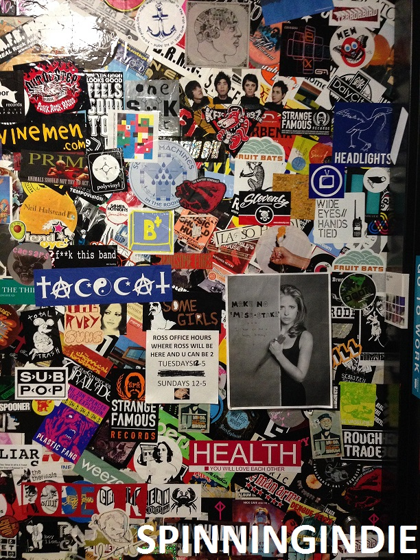 sticker-covered door at college radio station Radio K