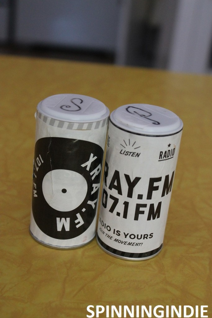 Sticker-plastered salt and pepper shakers at XRAY.fm. Photo: J. Waits