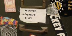 """Archived Important Files"" post on cabinet at college radio station WMCN. Photo: J. Waits"
