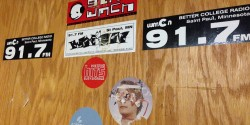 WMCN stickers at the Macalester College radio station. Photo: J. Waits