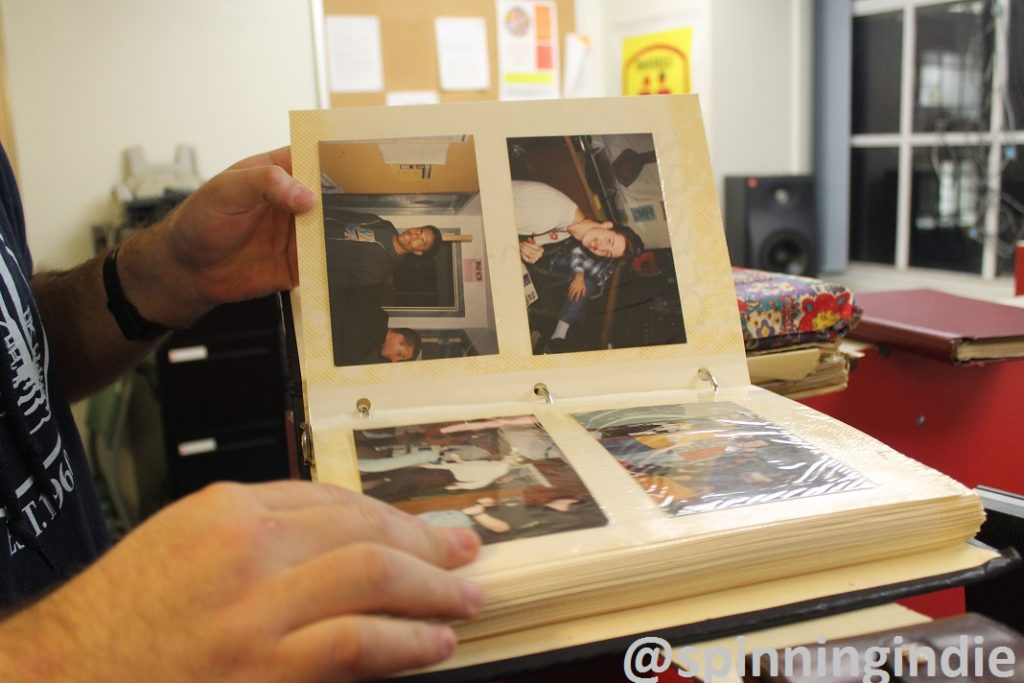 Looking at photo albums full of pictures and clippings at WBCR. Photo: J. Waits