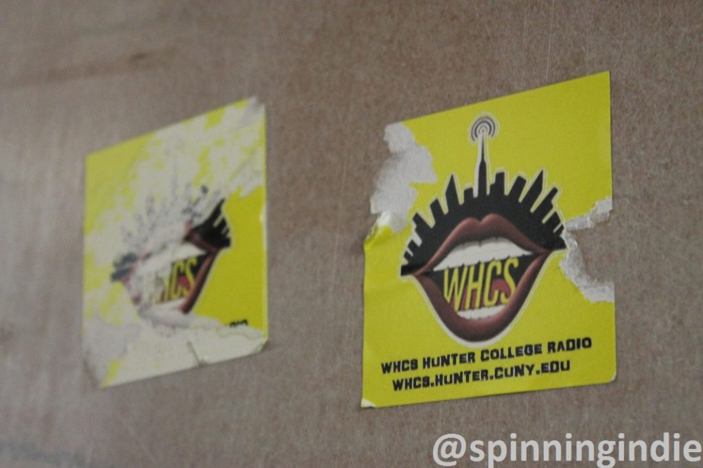 Old WHCS stickers on wall across from station's former home. Photo: J. Waits