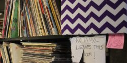 """No vinyl leaves this room"" sign at college radio station The SOCC. Photo: J. Waits"