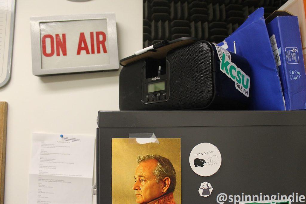 On Air sign, radio, and artifacts at KCSU. Photo: J. Waits