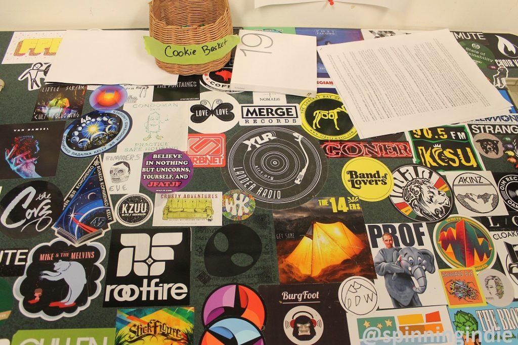 Sticker-covered desk at KCSU. Photo: J. Waits