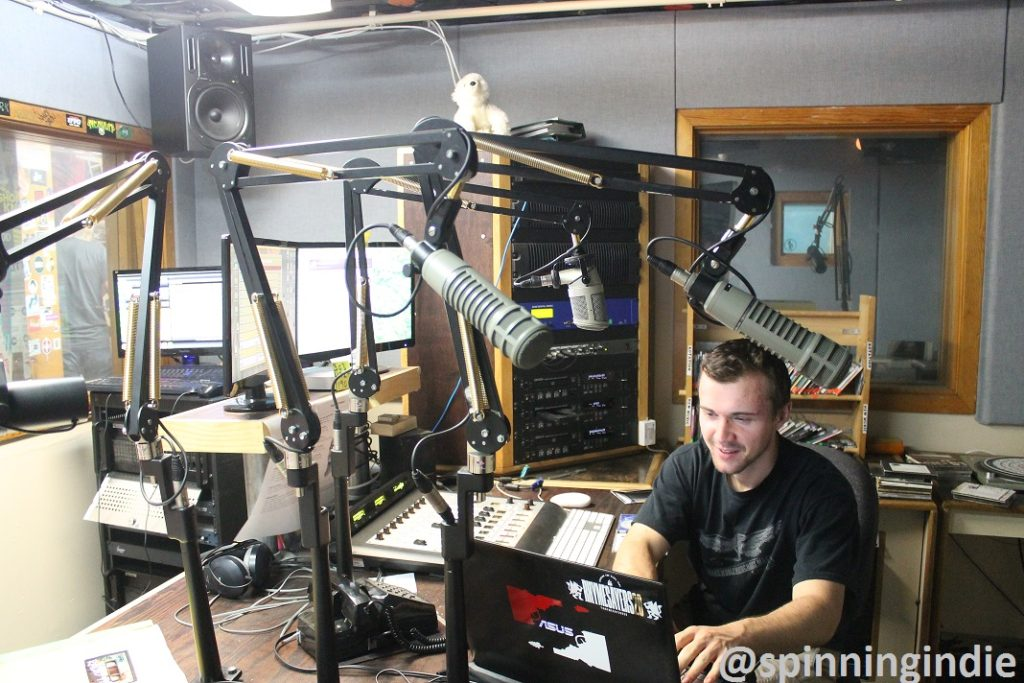 DJ in Radio 1190's on-air studio. Photo: J. Waits