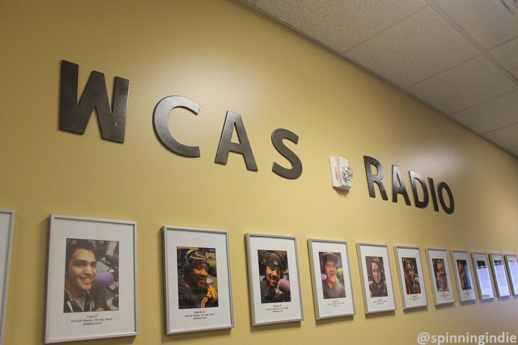 Hallway full of DJ and show host photos at WCAS Radio. Photo: J. Waits