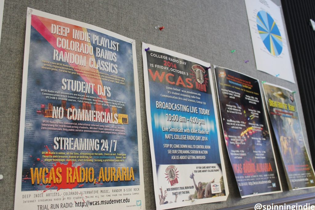 Promotional WCAS posters on the wall of the college radio station's studio. Photo: J. Waits