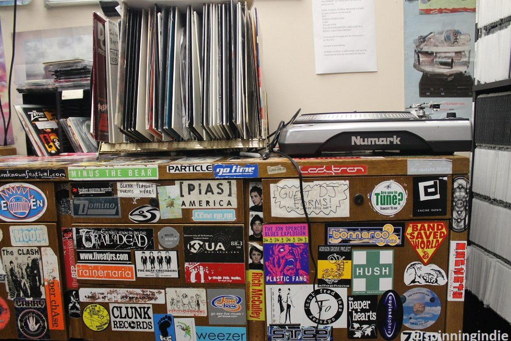 Turntable and vinyl records atop cabinet in KXUA on-air studio. Photo: J. Waits