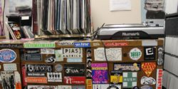 Turntable and vinyl records atop cabinet in college radio station KXUA's on-air studio. Photo: J. Waits