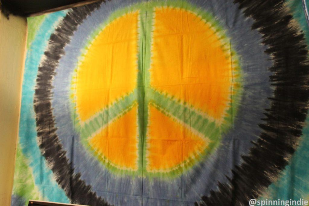 Peace sign tapestry in KPSQ-LP's future studio. Photo: J. Waits