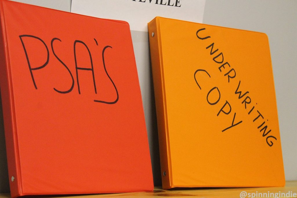 Binders for PSA and underwriting announcements at KPSQ-LP. Photo: J. Waits