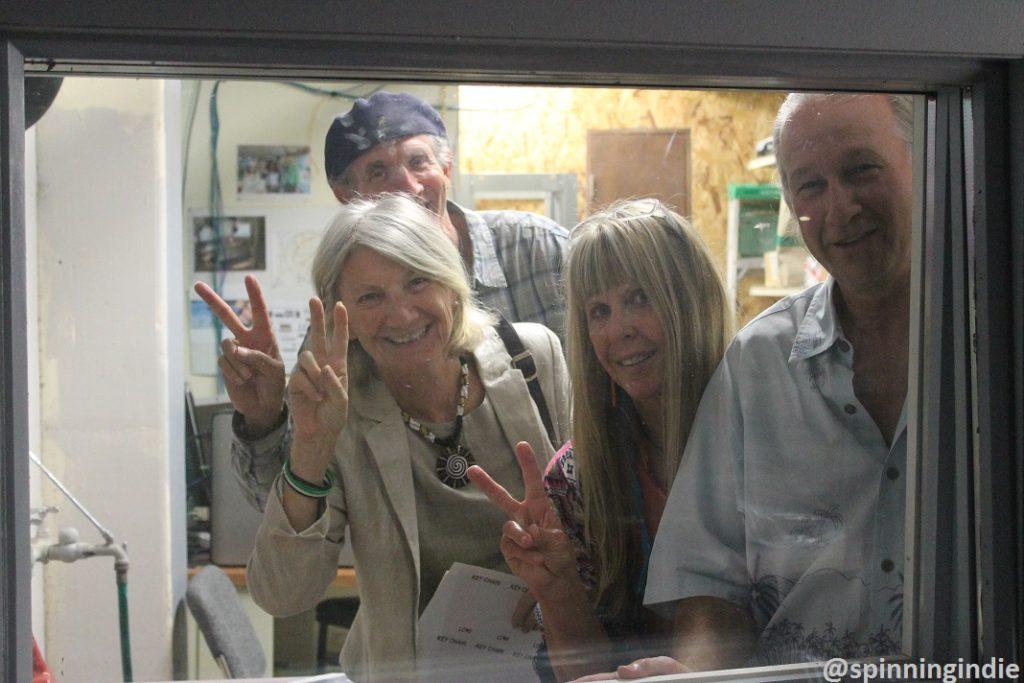 Moshe Newmark, Hamsa Newmark, Dawn Newman and Joe Newman peek out of the future KPSQ-LP studio window. Photo: J. Waits
