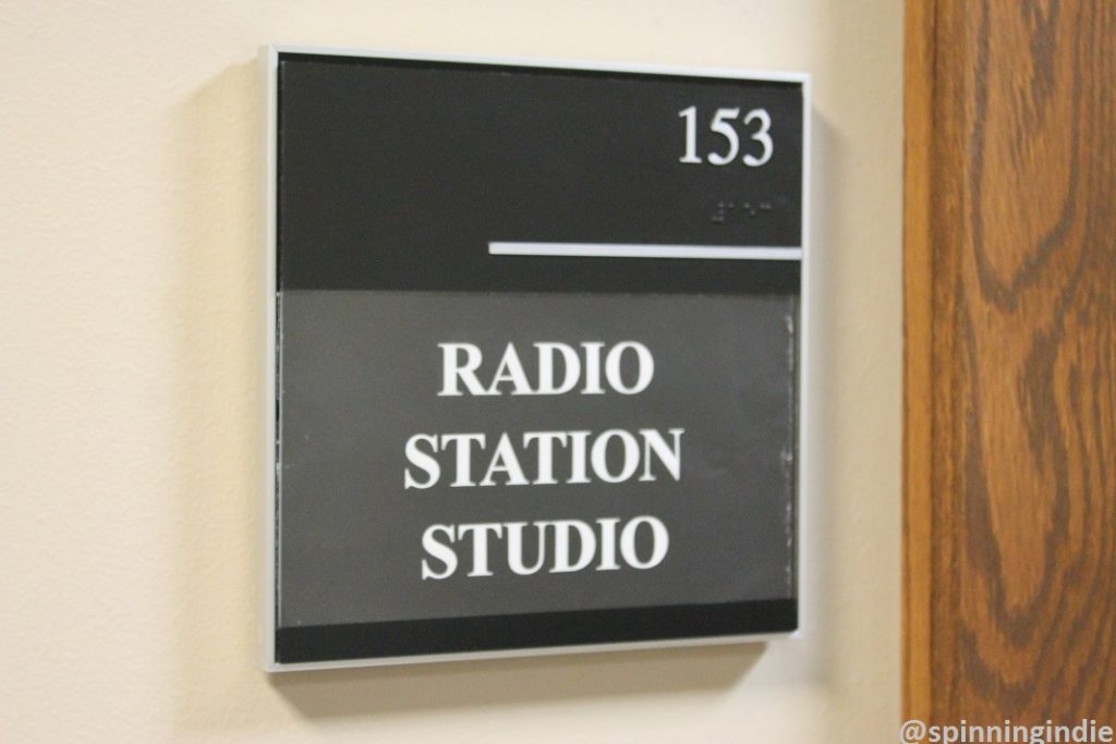Radio station studio sign outside college radio station KUOZ-LP. Photo: J. Waits