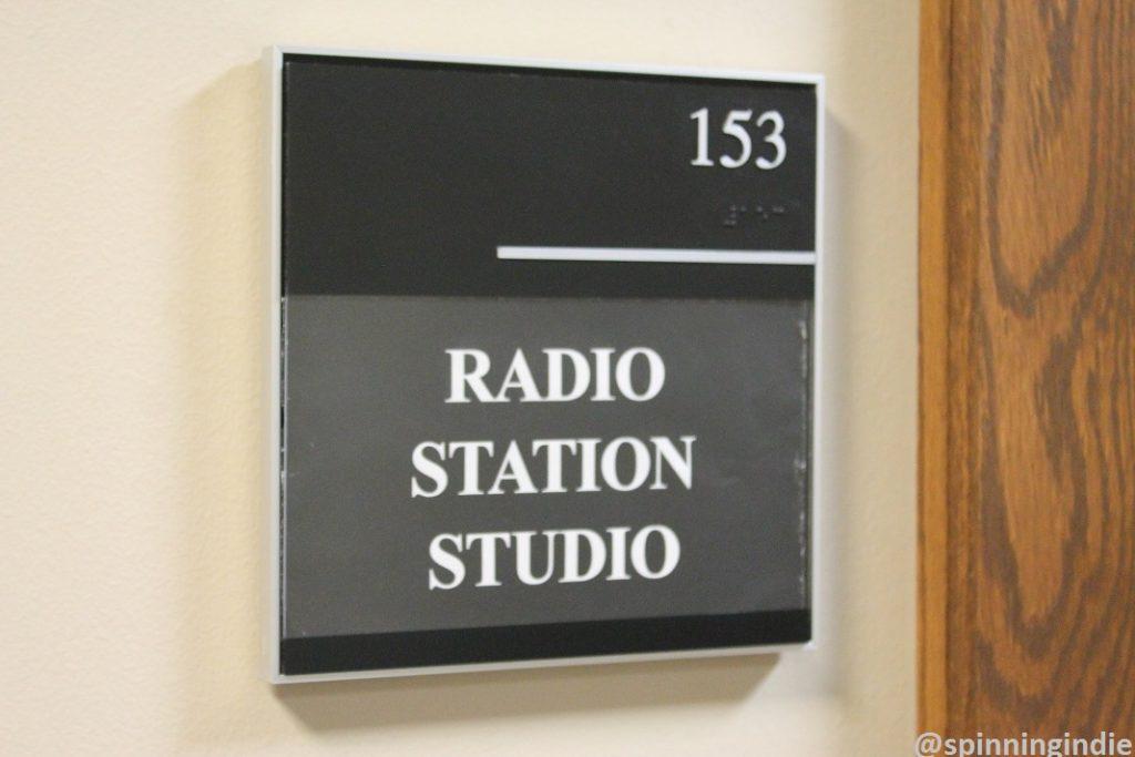 Radio station studio sign outside college radio station KUOZ-LP. Photo: J. Waits