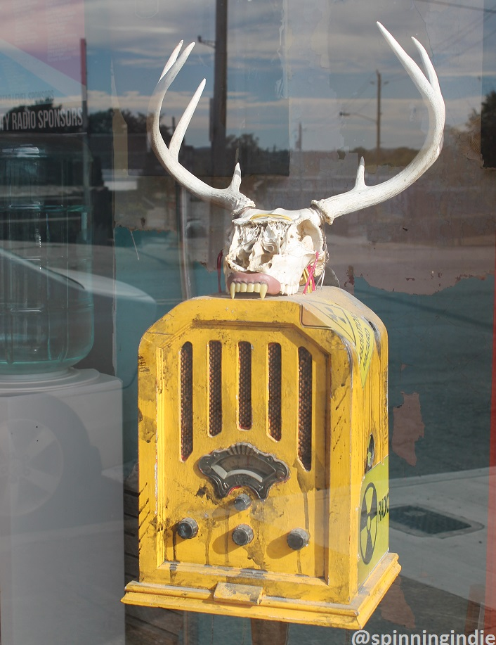 Radio art piece in window at KUHS-LP. Photo: J. Waits