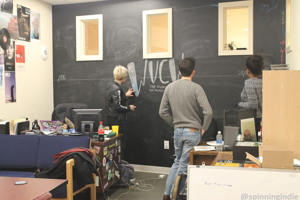 WVCW staffer draws a timeline on the chalk board while Alan Booth and Kiara Walker look on. Photo: J. Waits