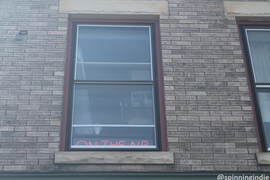 On-air sign in window of community radio station WRIR-LP. Photo: J. Waits