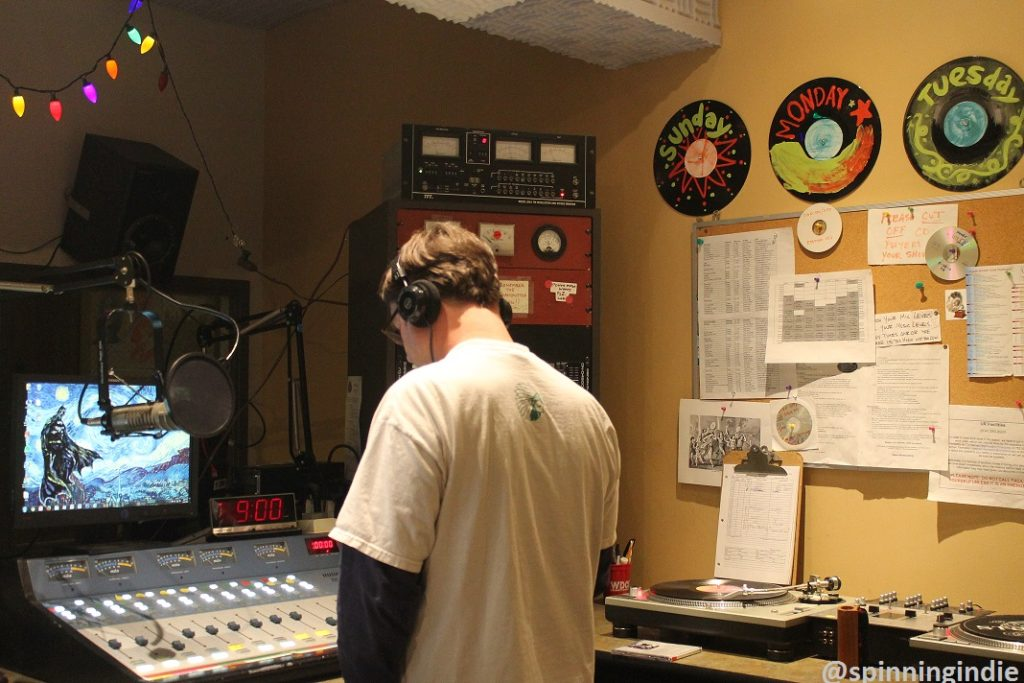Todd Ranson doing his show at college radio station WDCE. Photo: J. Waits
