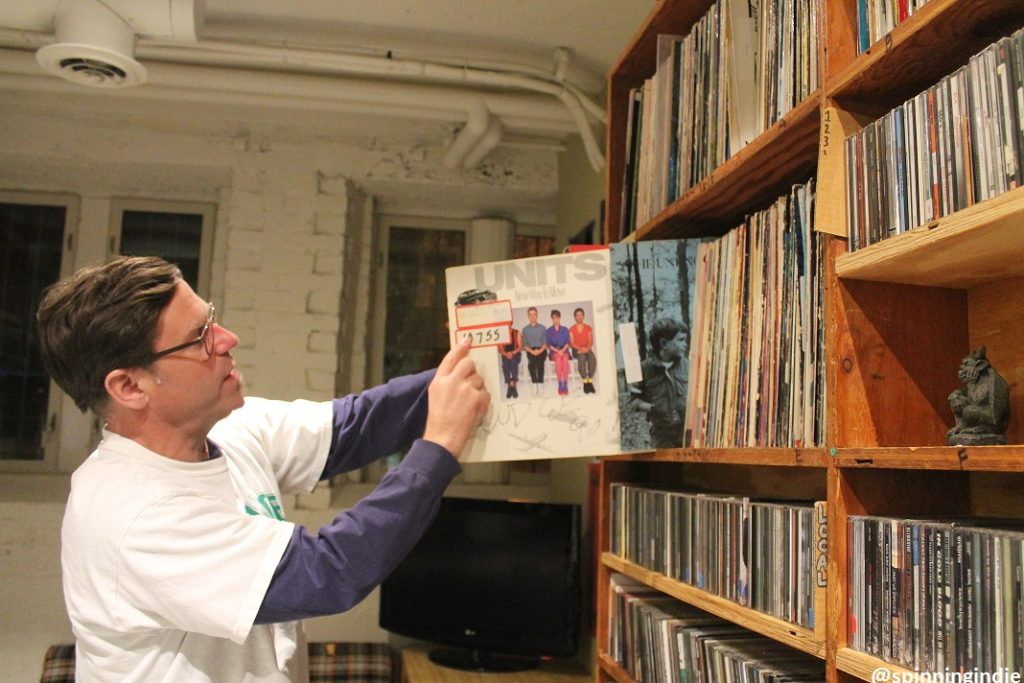 WDCE DJ Todd Ranson peruses the college radio station's library of vinyl LPs. Photo: J. Waits