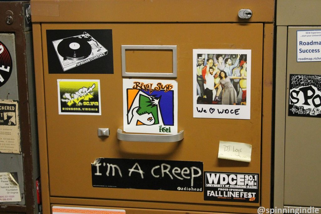 Sticker-covered file cabinet at WDCE. Photo: J. Waits