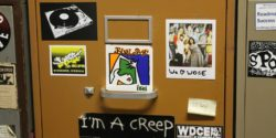 Sticker-covered file cabinet at college radio station WDCE. Photo: J. Waits