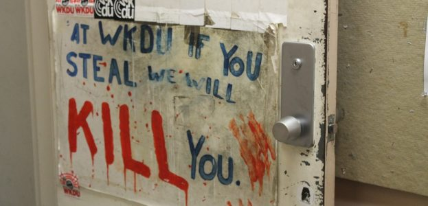 """""""WKDU if you steal, we will kill you"""" sign on the door to the college radio station. Photo: J. Waits"""