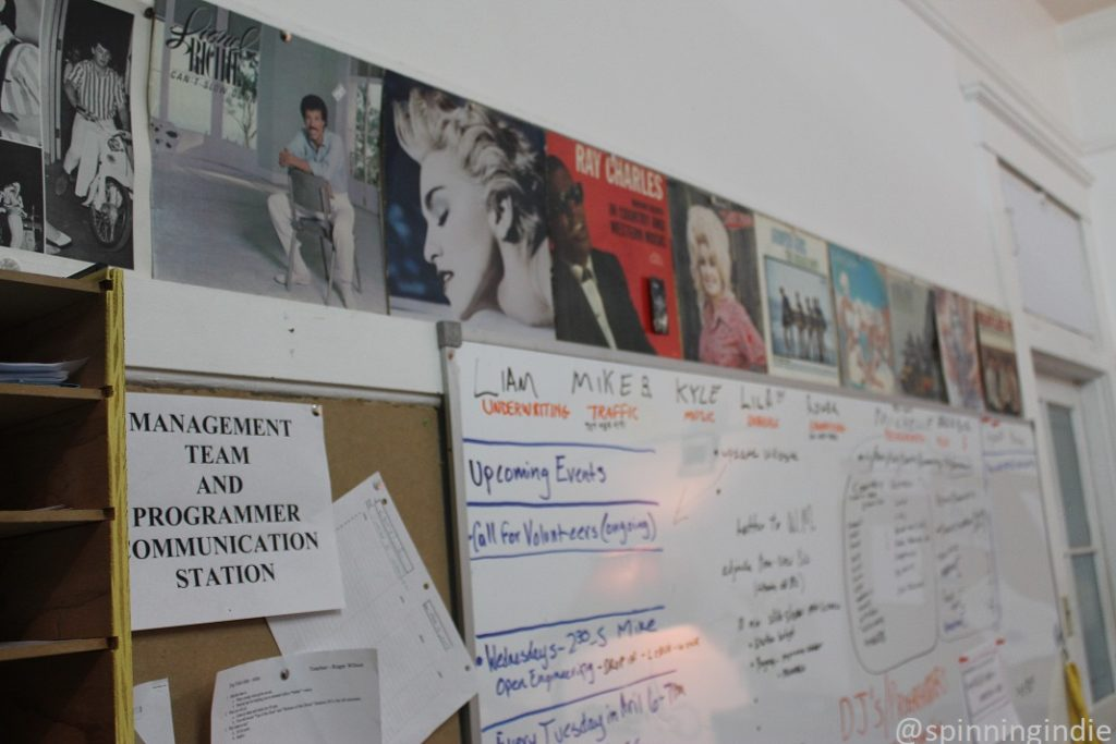 Album covers above bulletin board and white board at KLLG-LP. Photo: J. Waits/Radio Survivor