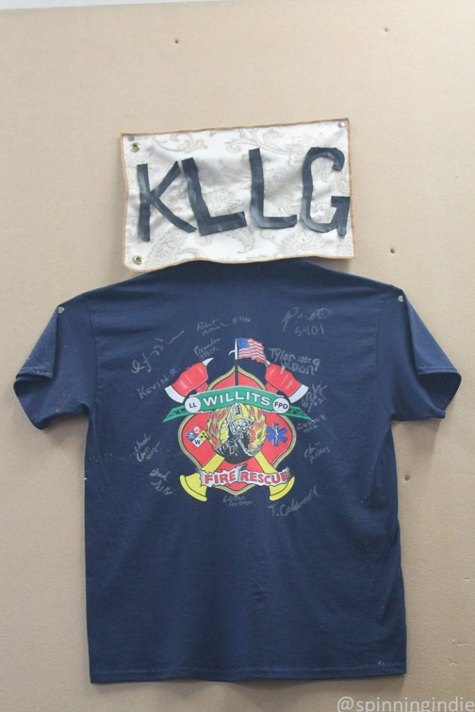 Signed Willits Fire Rescue T-shirt on wall of KLLG-LP in April, 2017. Photo: J. Waits/Radio Survivor